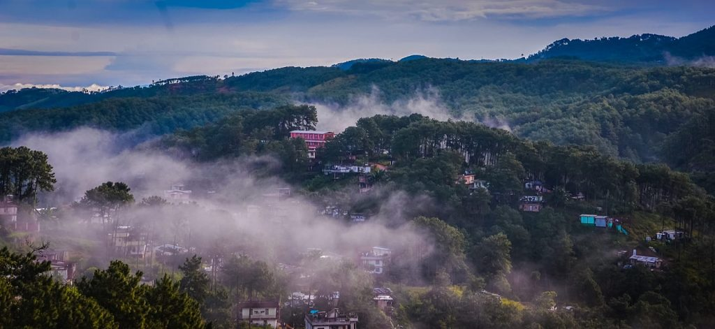 lush green valley with clouds in shillong
