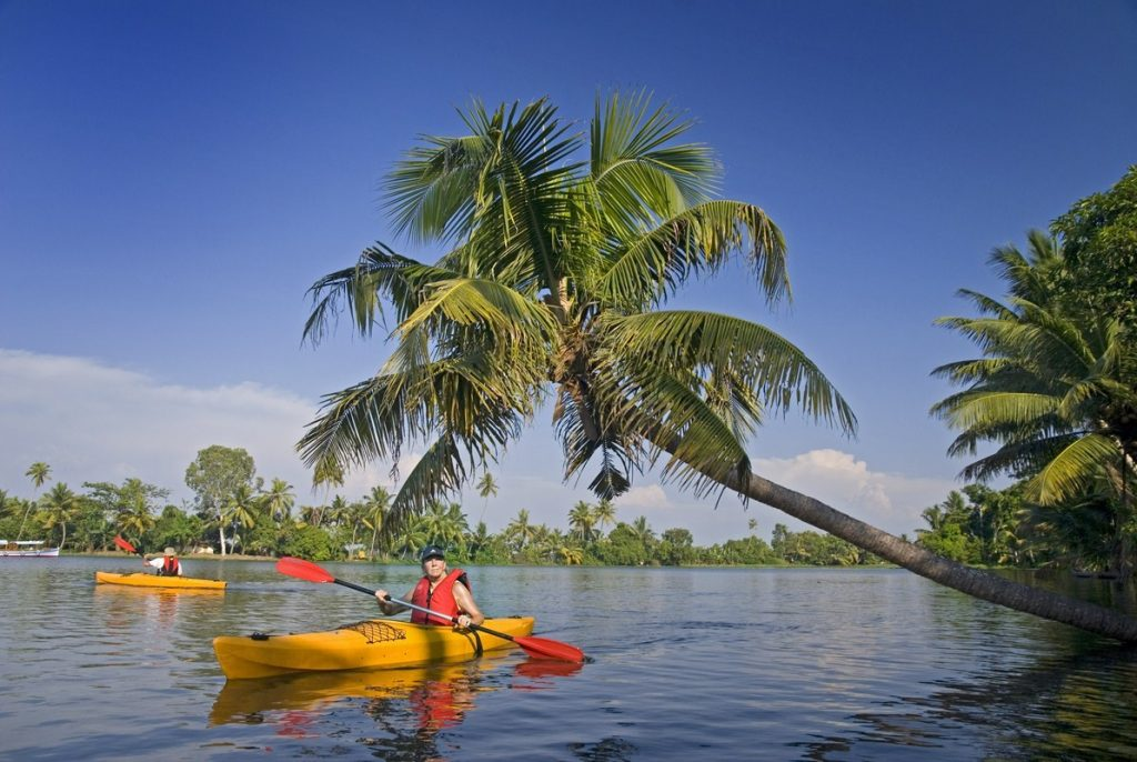 person doing kayaking in backwaters of alleppey, one of the Kayaking places in India