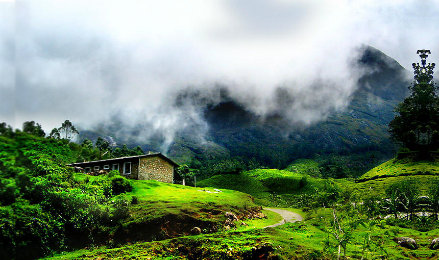 lush green valley and guesthouse in idukki