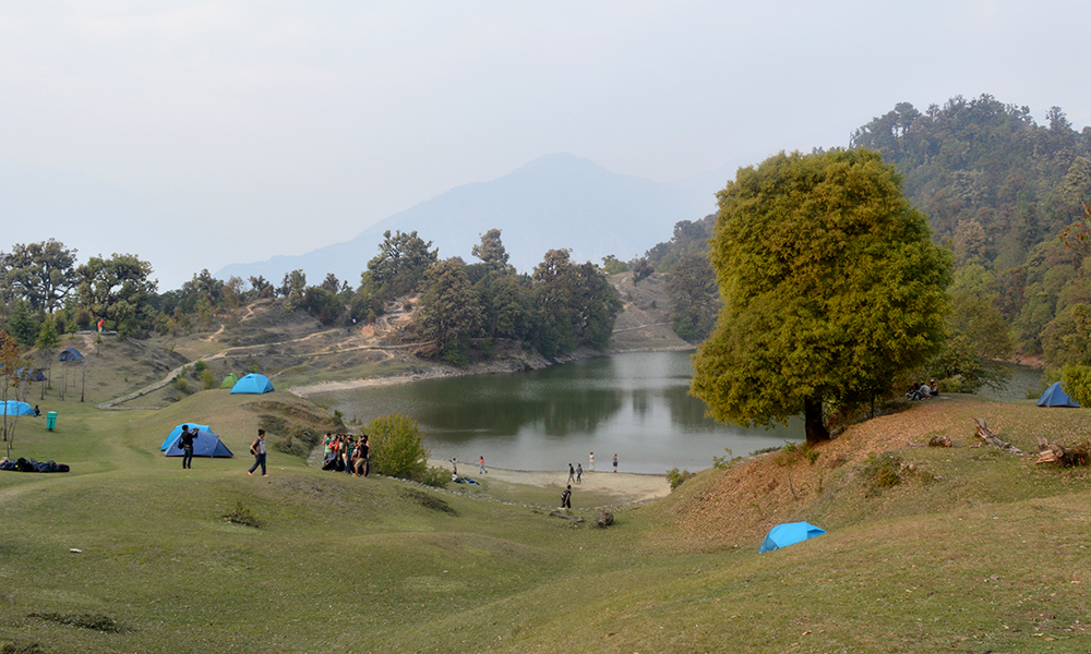 picturesque view of deoria tal with tents