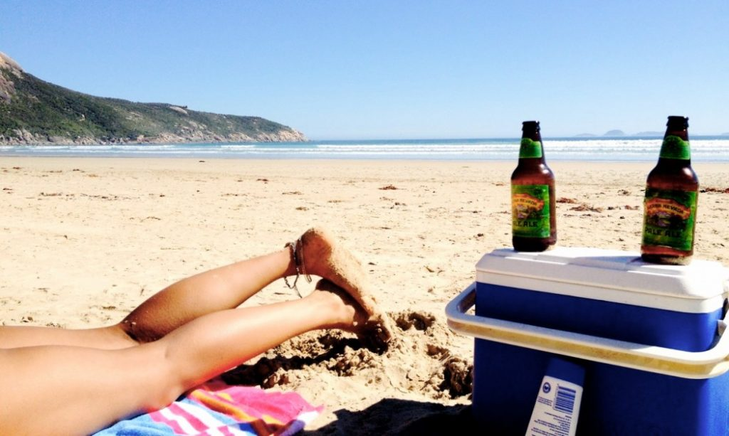 two beer bottle on a beach
