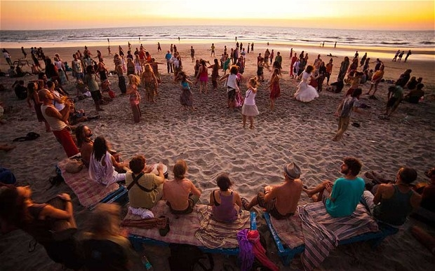 people celebrating sunset moments on a beach in goa
