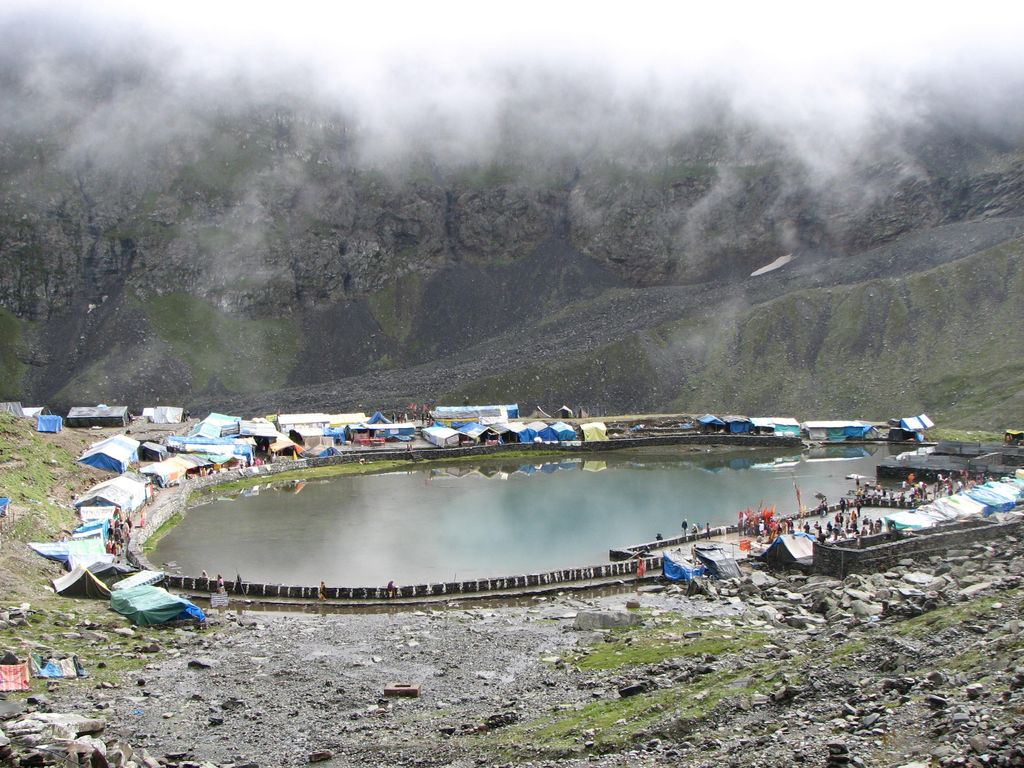 manimahesh lake with camps surrounding