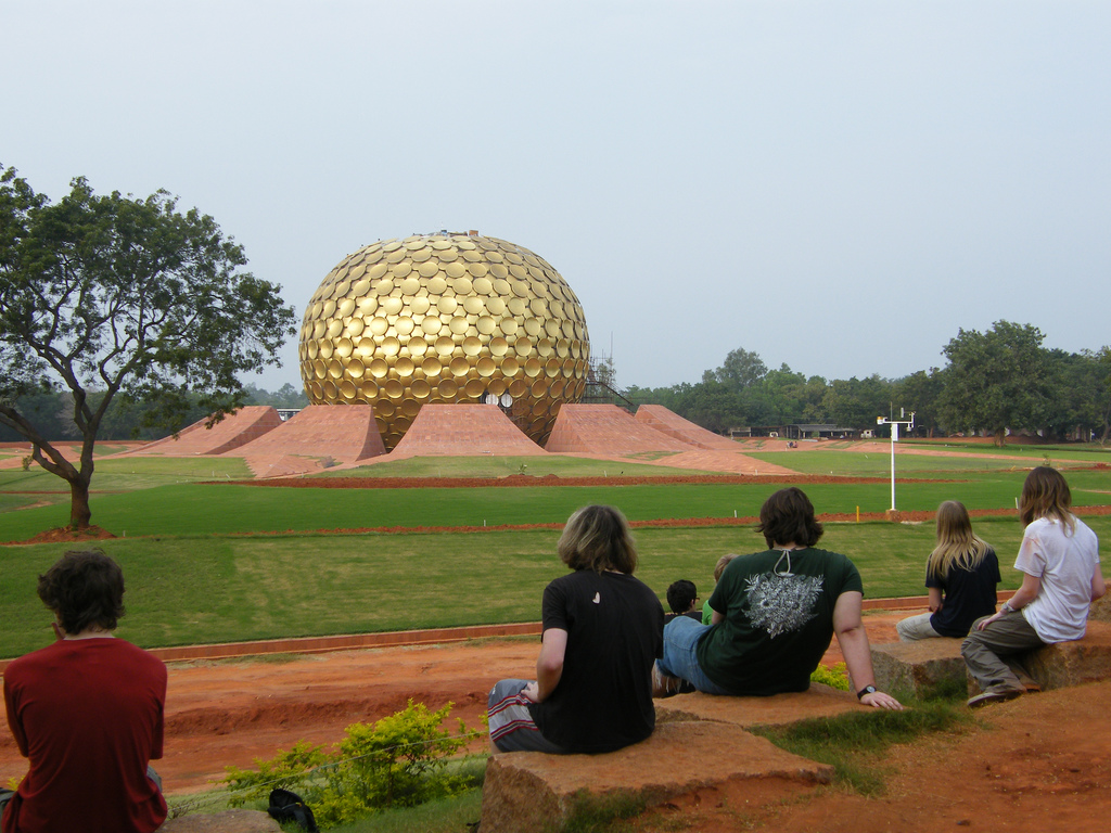 people sitting around matri mandir in Auroville