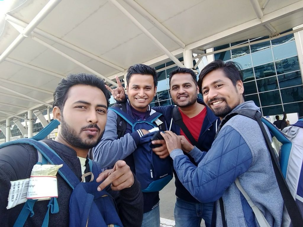 four friends at goa airport