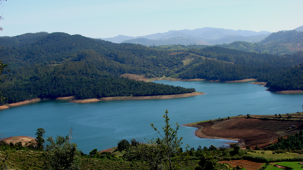 river with lush green valley of ooty