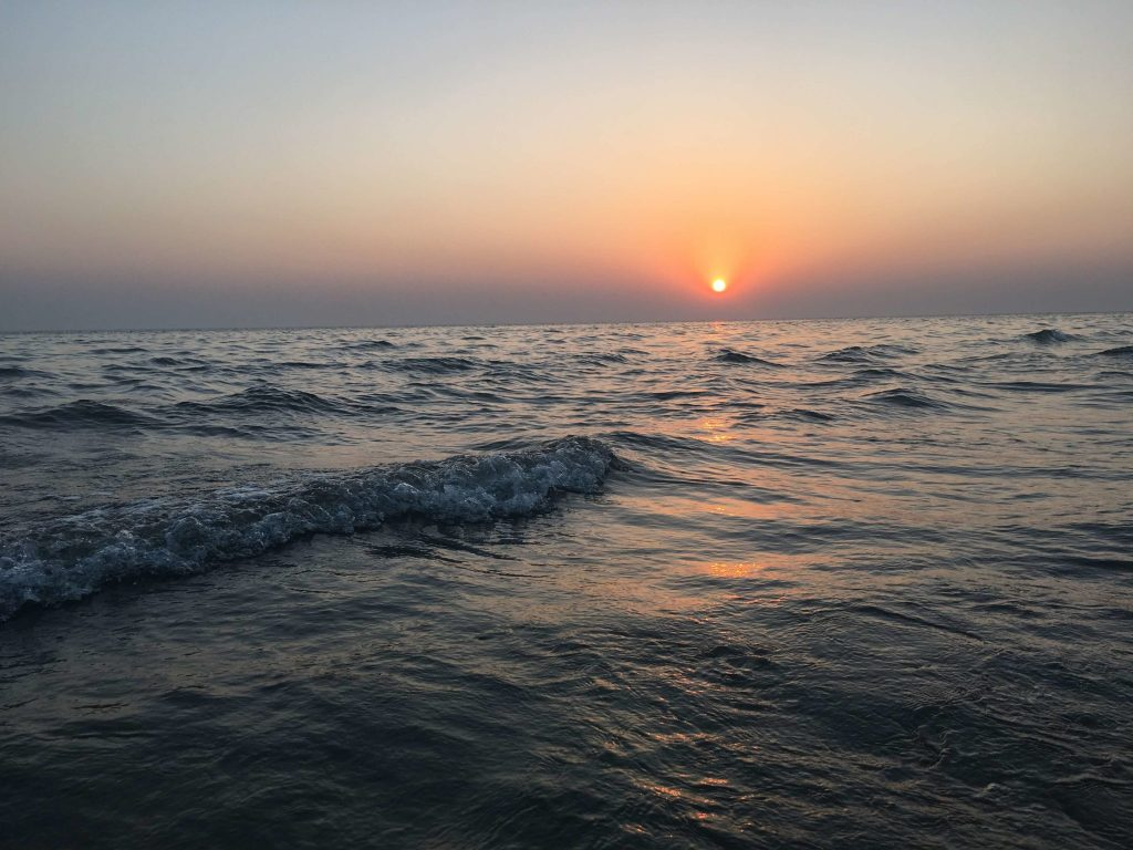 Sun sets in ocean at Mandvi