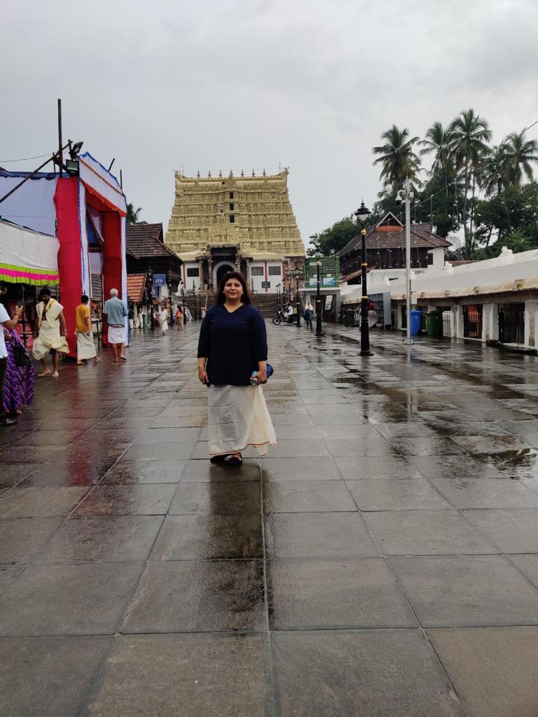 girl standing at Padmanabhaswamy temple in kerala with the temple in background