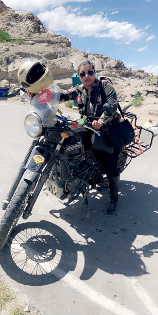 girl standing with her bike in leh