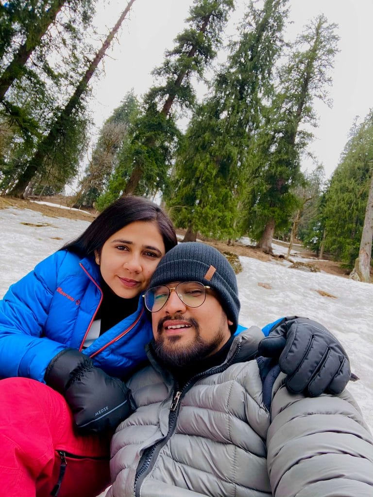 couple posing with snow in background