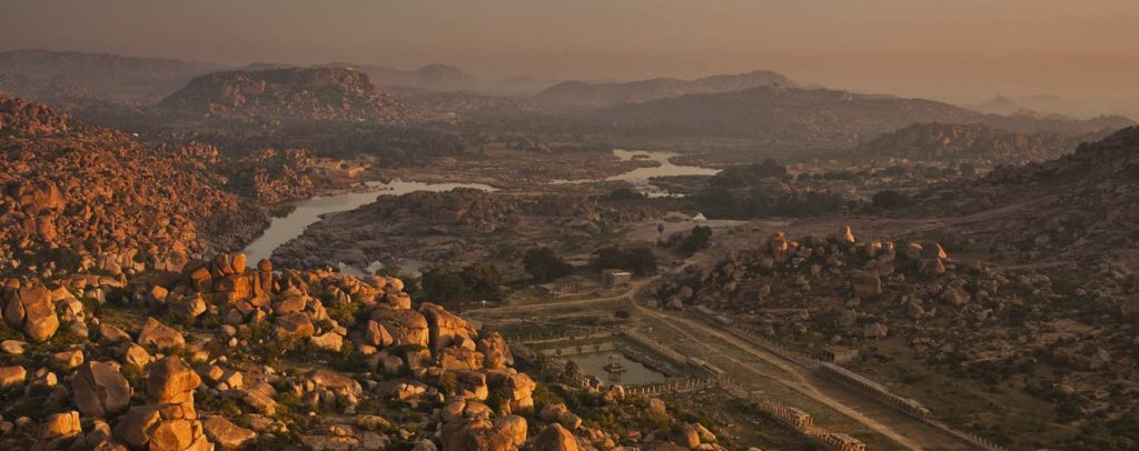 View of Hampi with big boulders all around and Tungabhadra river